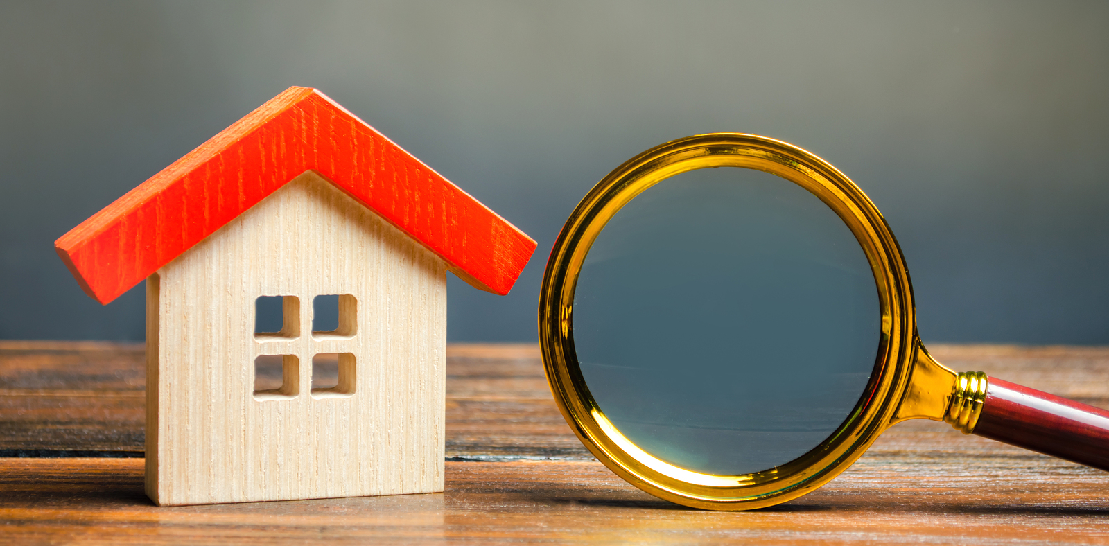 Miniature Wooden House And Magnifying Glass. Home Appraisal. Pro